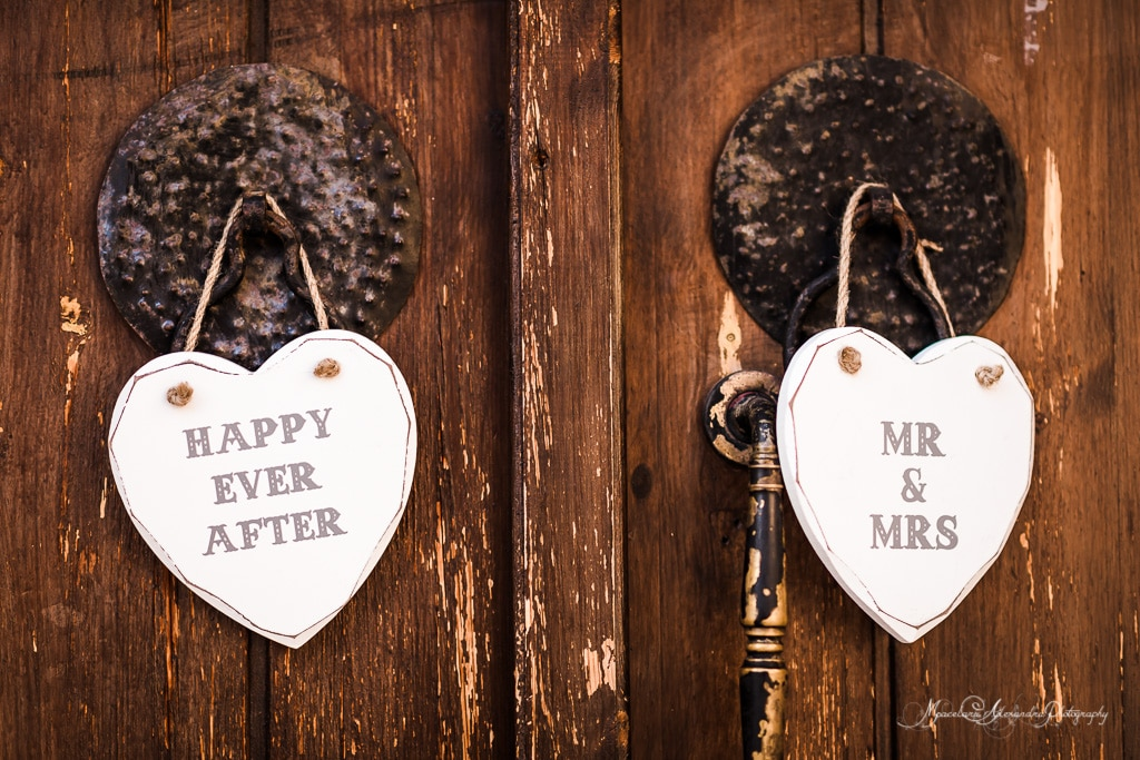 Two heart shaped signs hanging on the door at the Minthis Hills's Monastery