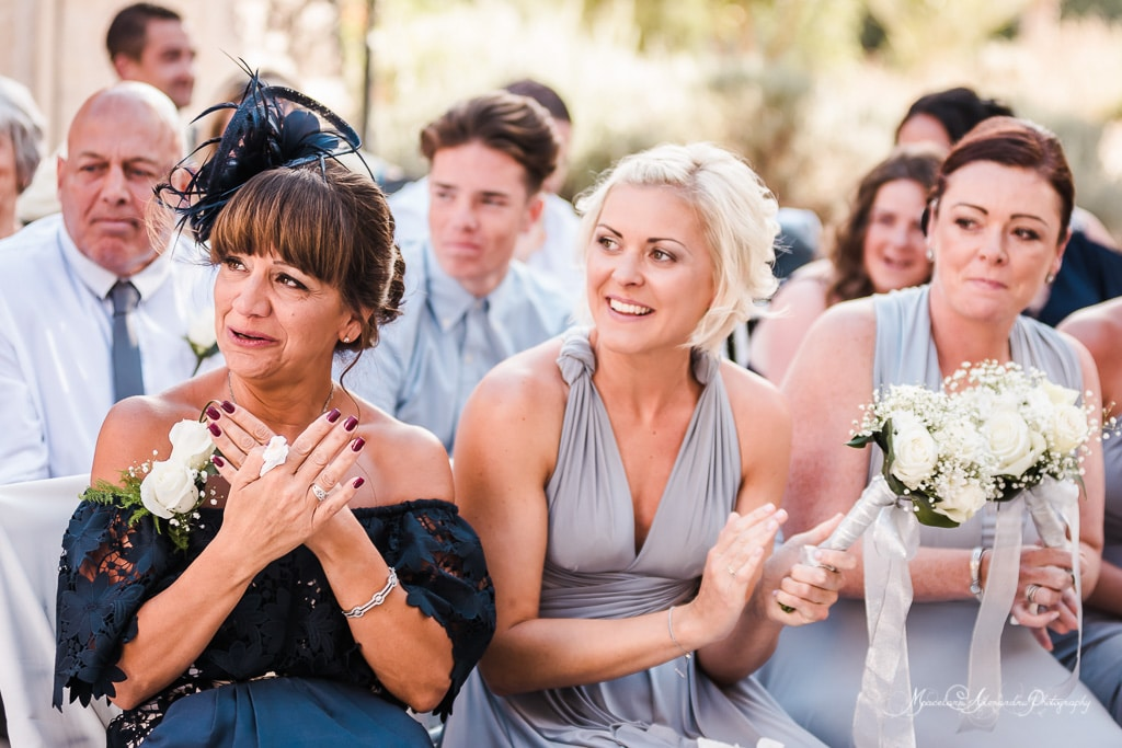 The mother of the bride at the ceremony, the look on her face is priceless