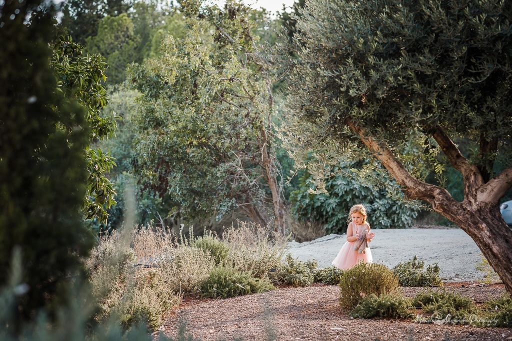 This image is about a little girl on her own enjoying the nature at Claire and Steve's wedding