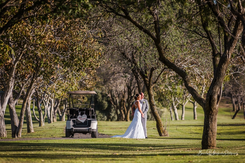 The wedding couple enjoying the views at Minthis Hills golf course