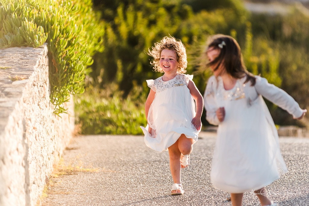 A beautiful image showing two kids playing at the wedding party