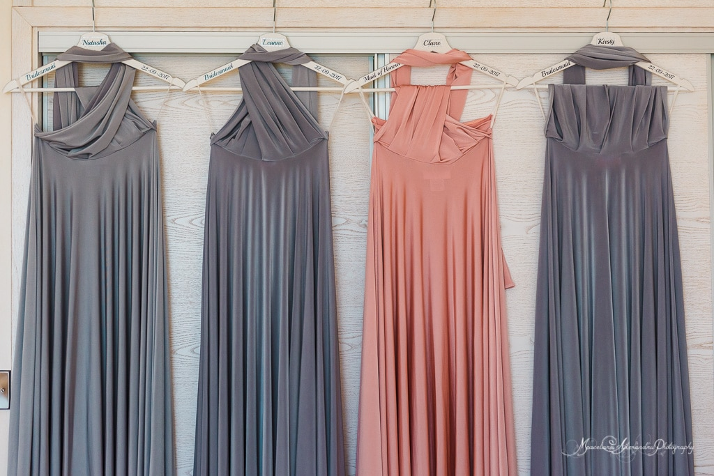 Another image of the brides maids dresses hanging moments before the departure at Minthis Hills for the wedding.