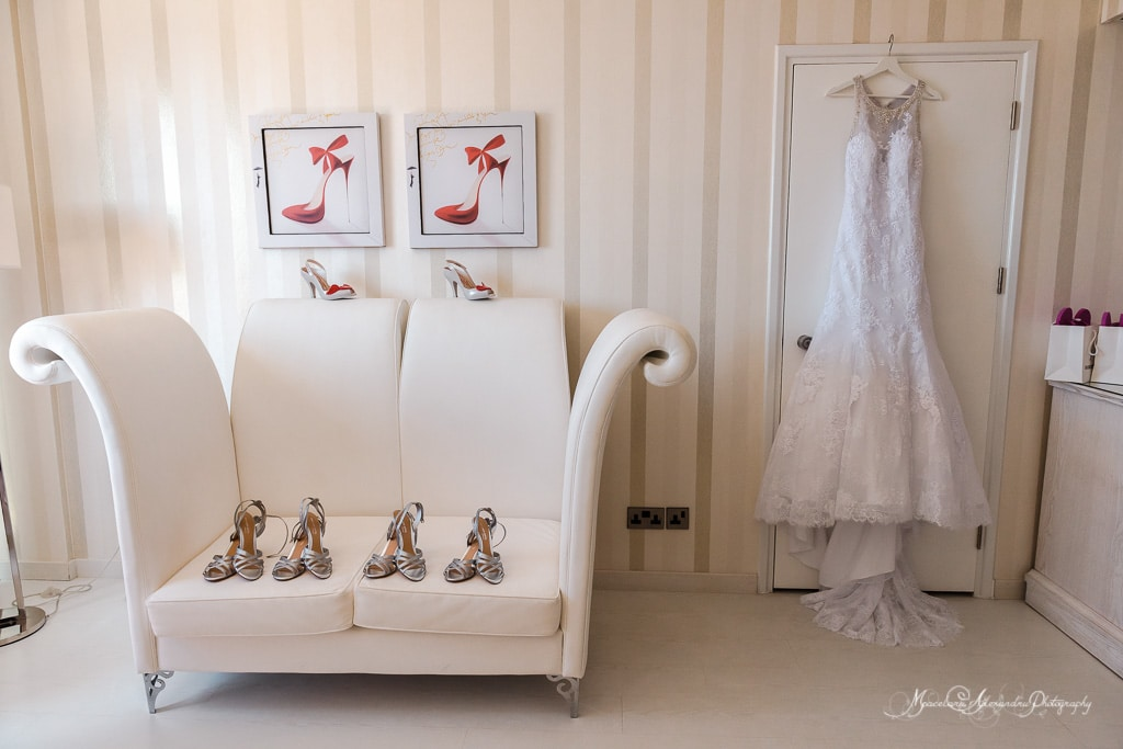 The wedding dress and the shoes of the bride, ready for the wedding at the amazing Minthis Hills Paphos