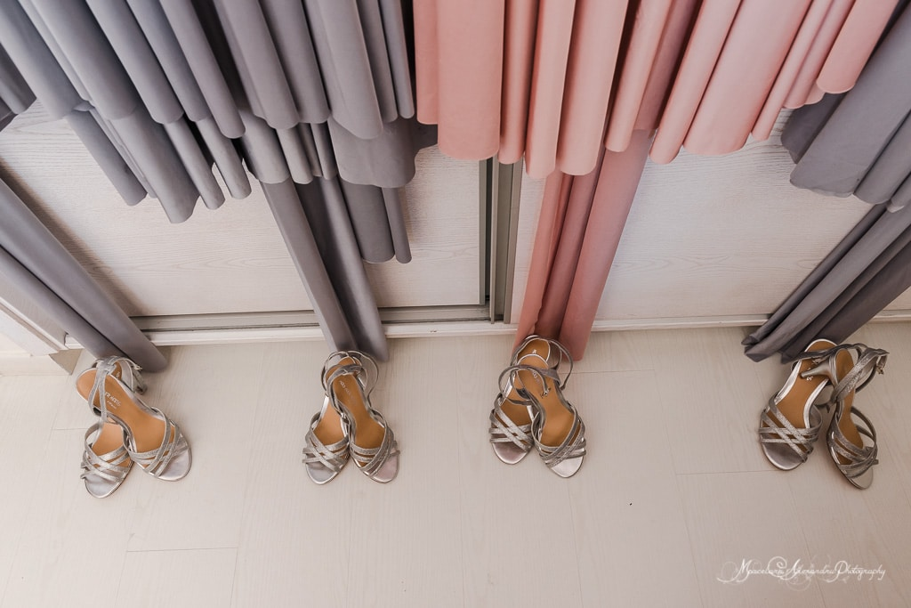 The bridesmaids dresses hanging, while they are getting ready for the wedding at Minthis Hills