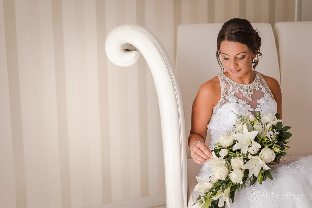 Beautiful image of the bride before the wedding at minthis hills, the bride is holding her flowers.