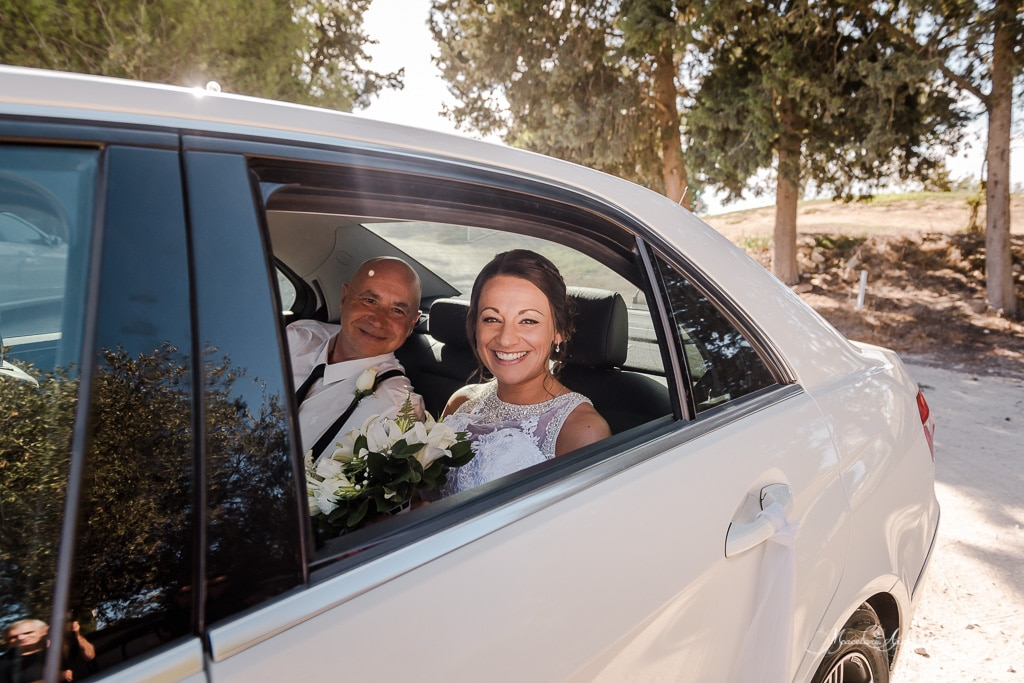 Claire and her father arriving for the wedding at Minthis Hills, in a white beautiful car