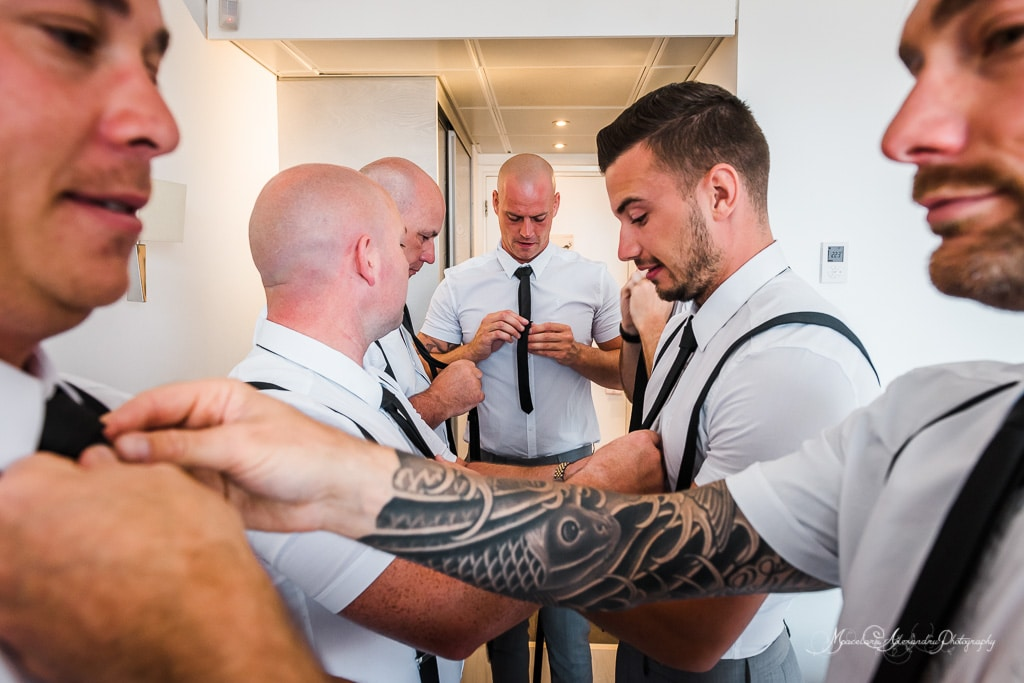 The grooms men are all getting ready for the wedding at Minthis Hills.