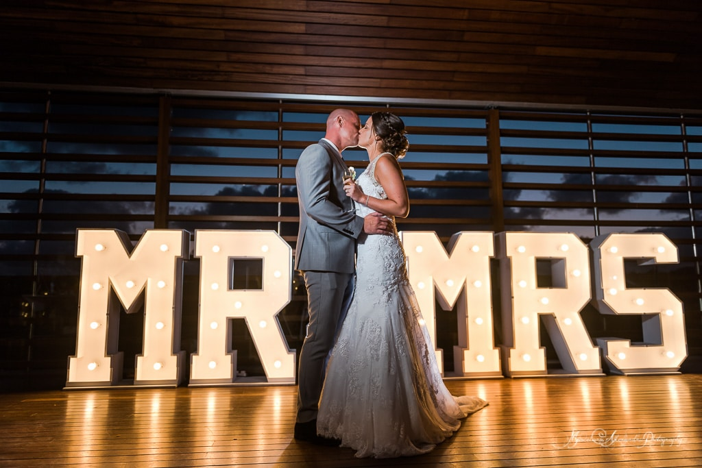 The first dance with a beautiful MR and Mrs letters on the background , they have been specially made for them by the amazing team at Minthis Hills