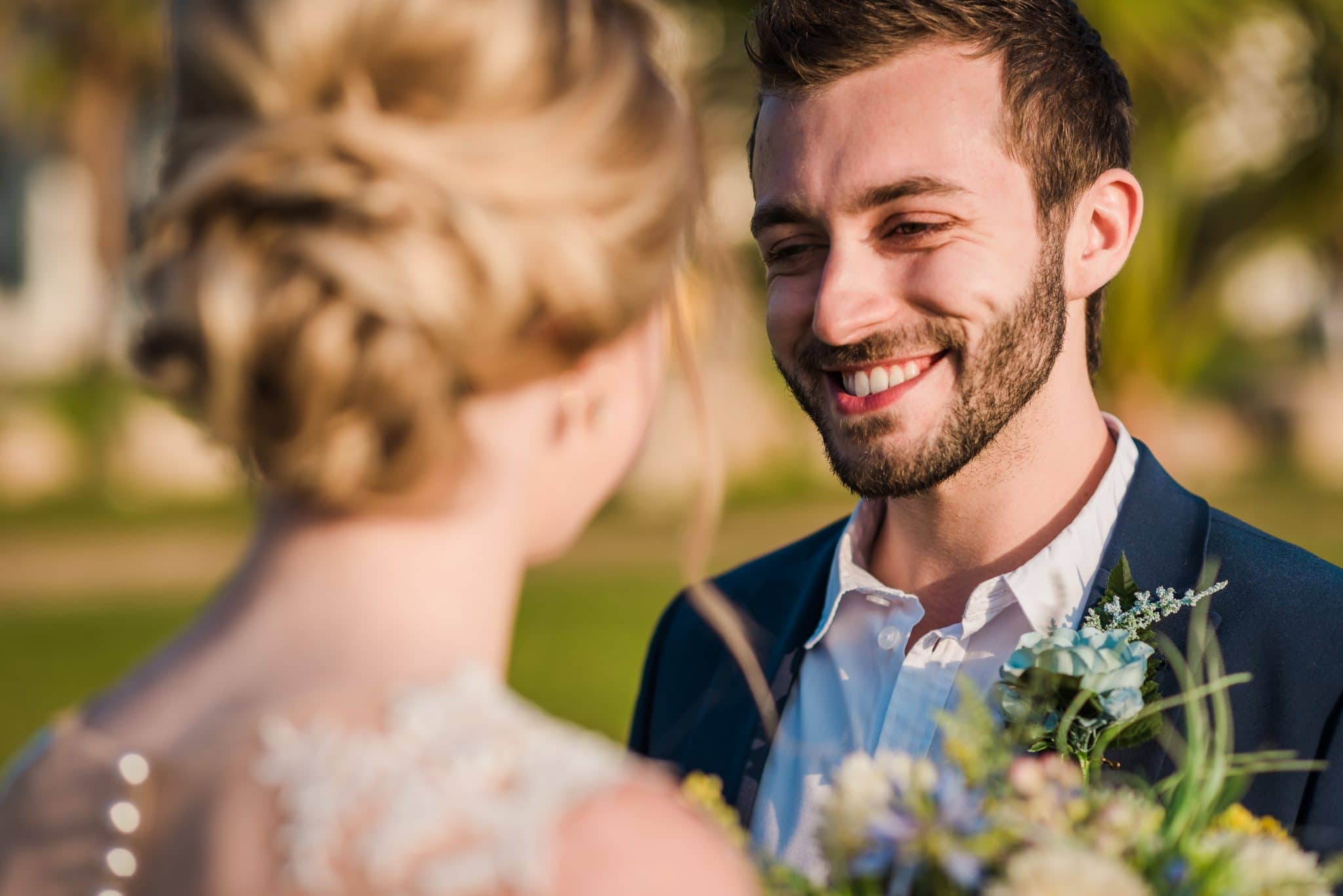 The groom smiles at his bride, great moment for a Paphos wedding photographer like me .