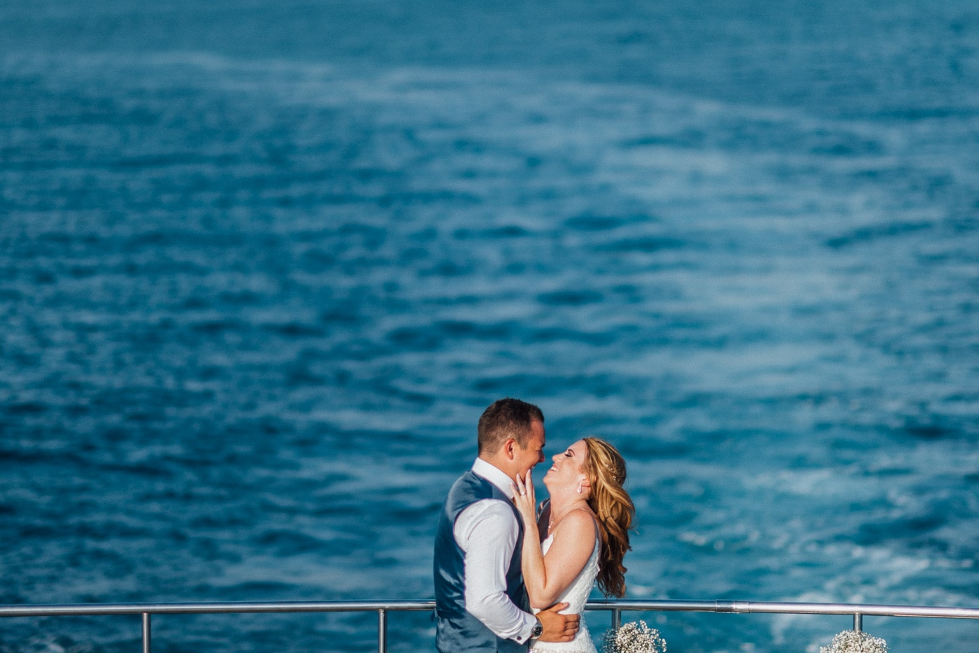 Lovely couple on the yacht and the blue sea, wedding photographer in Cyprus Alexandru Macelaru