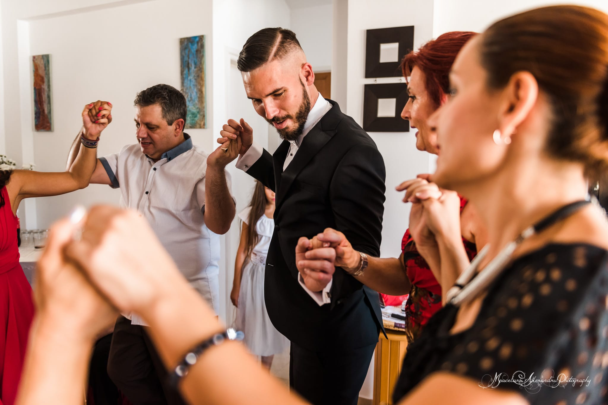 Wedding photography in Paphos - The groom is dancing with the wedding party