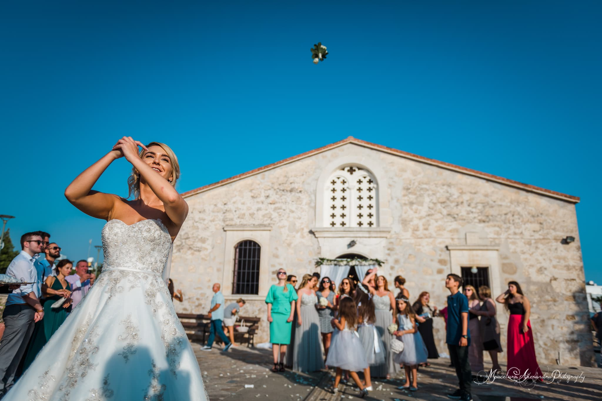 Wedding photography in Paphos - The bride throws the bouquet