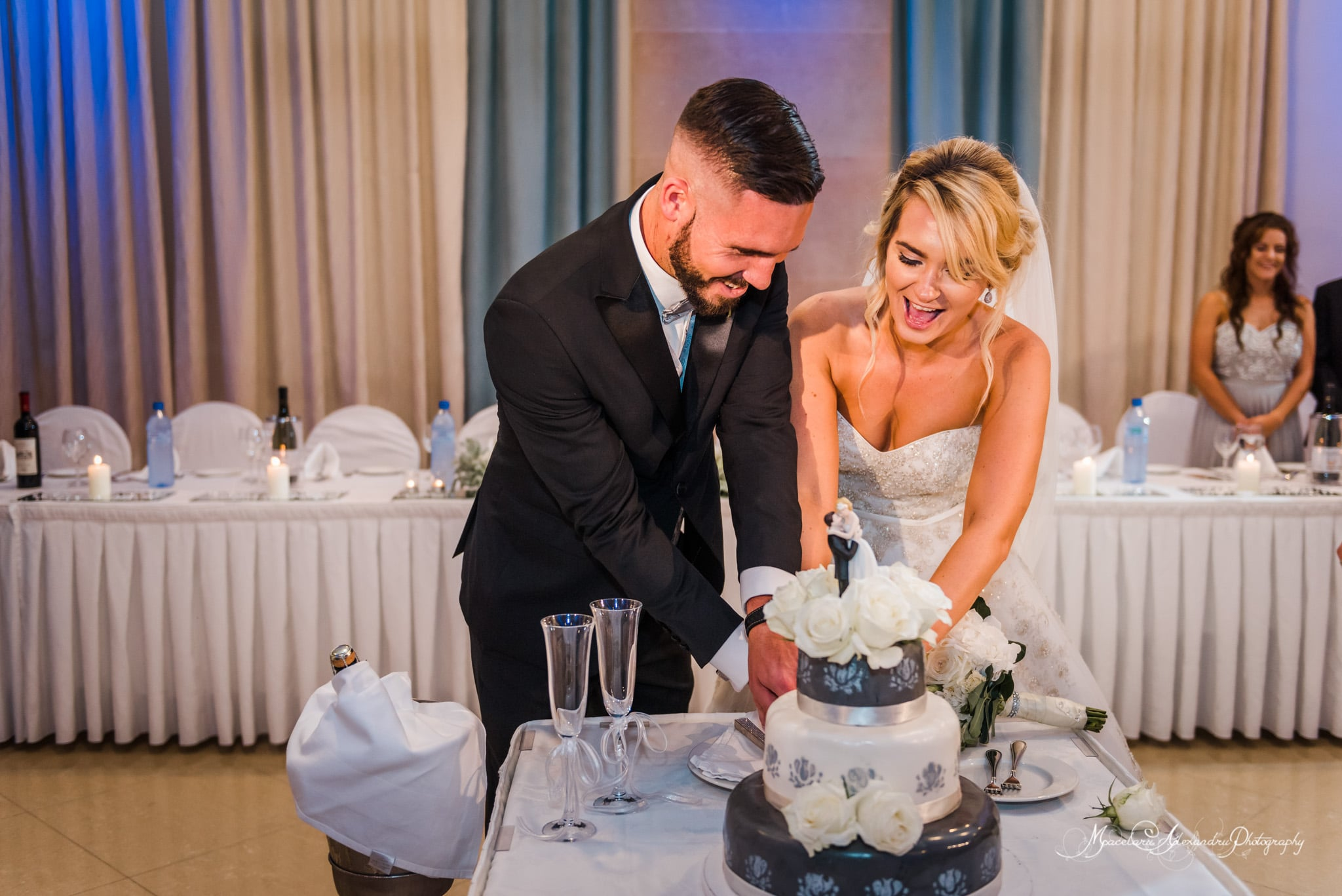 Wedding photography in Paphos - Bride and Groom are cutting the cake