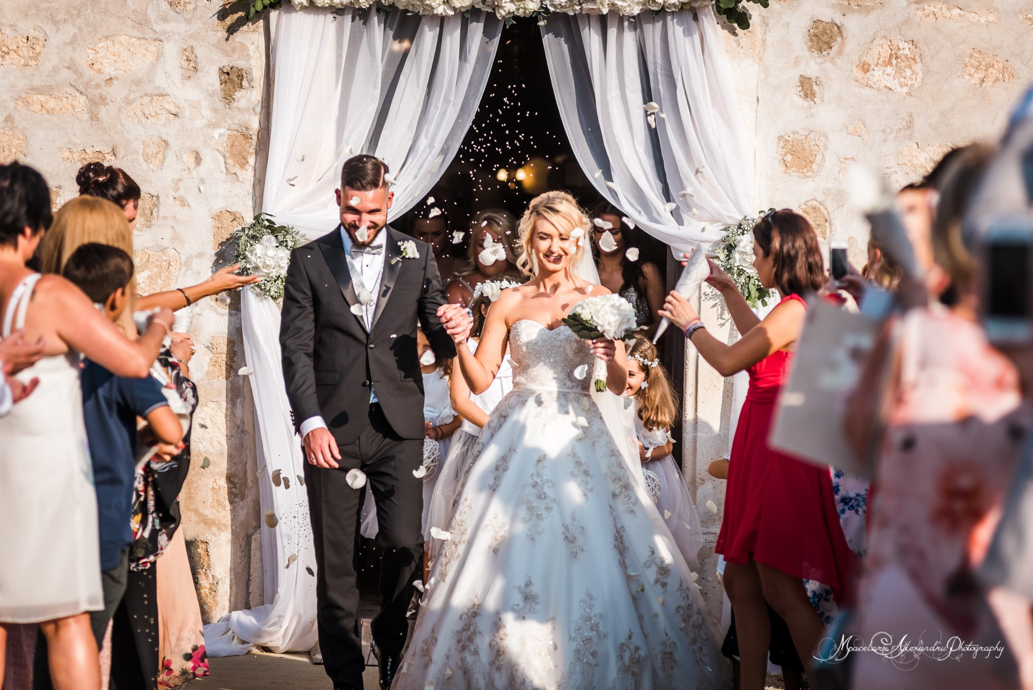 Wedding photography in Paphos - Bride and groom exit the church