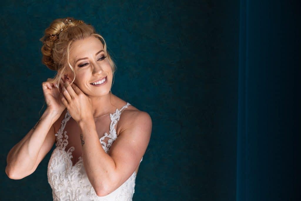 Bride wearing the earrings - Photographer Cyprus