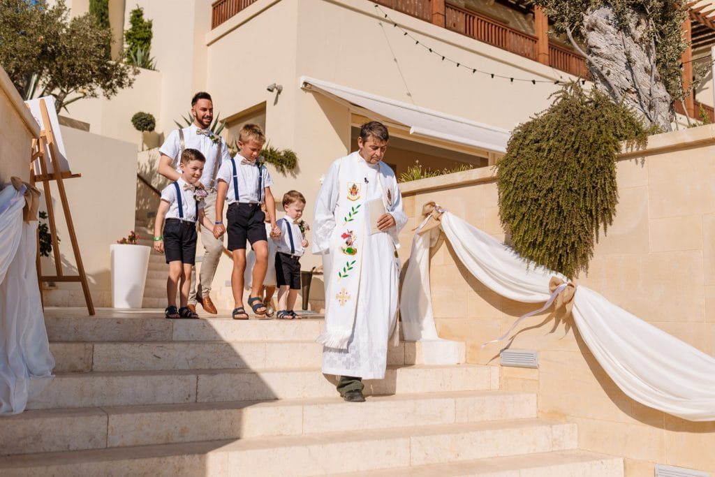 The priest arriving with the kids