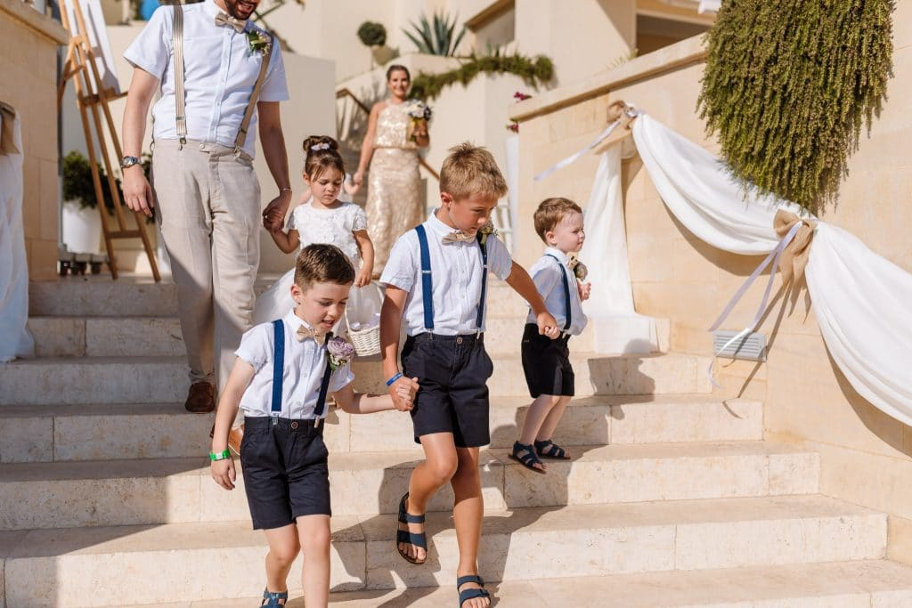 Pageboys walking down the stairs - wedding photography Cyprus