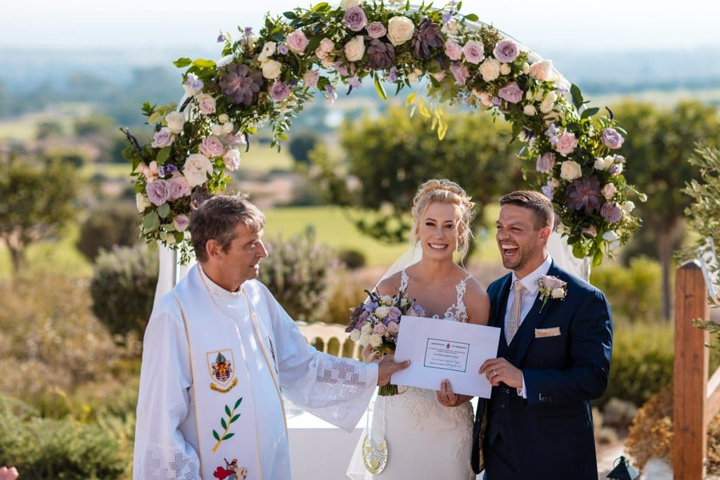 Bride and Groom with their marriage certificate