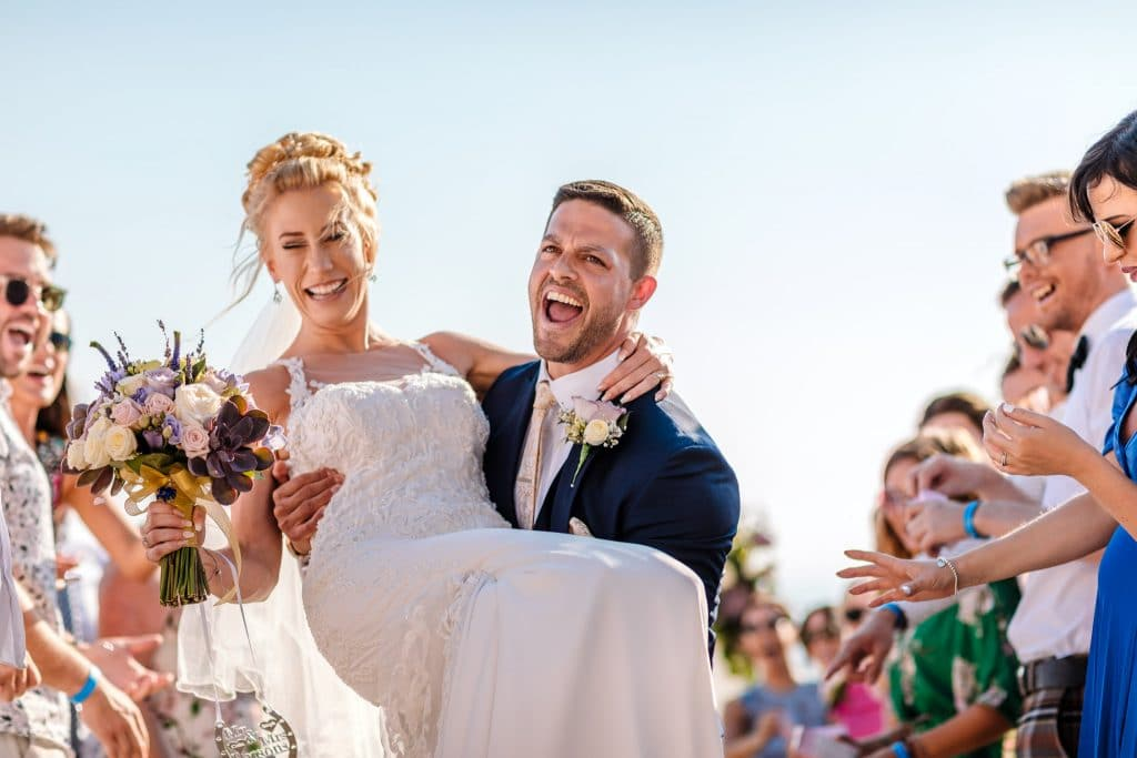 Groom holding the Bride in his arms - Wedding photos at Elea Estate