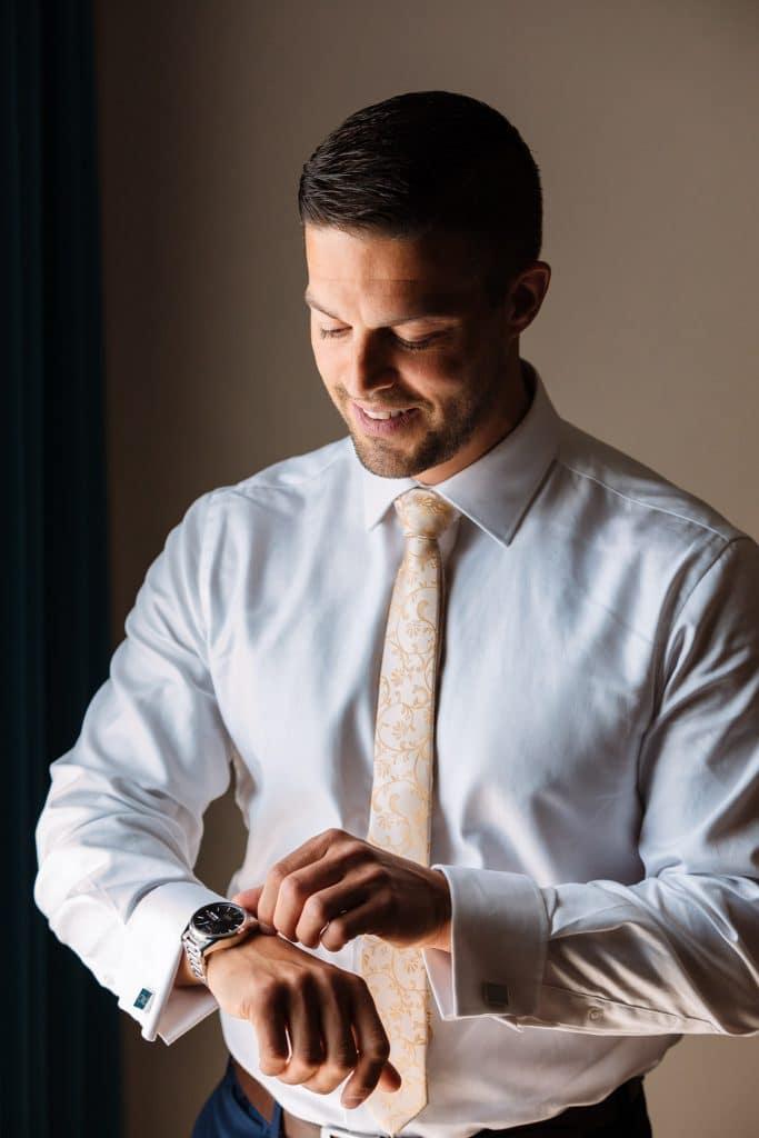 Groom wearing his watch - Cyprus wedding photos